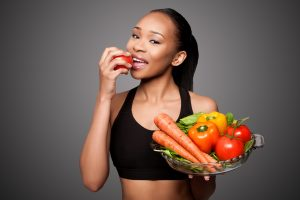 woman smiling eating healthy salad